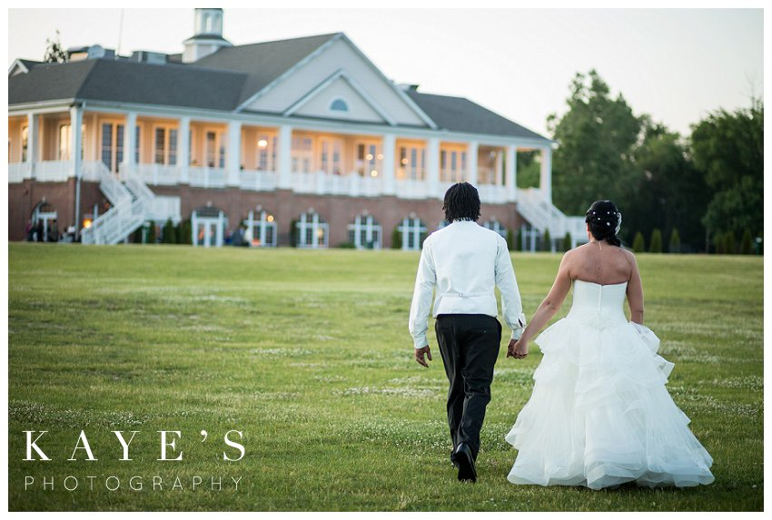Captain's Club Wedding Photographer, Captains Club Grand Blanc Michigan Wedding photography, grand blanc michigan wedding portraits,mid michigan wedding photography, bride and groom walking away, happily married, holding hands, love