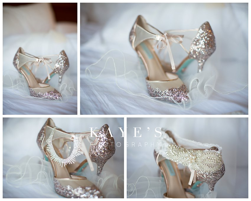 Bride's shoes posed for wedding day portraits with veil and garter in ann arbor michigan