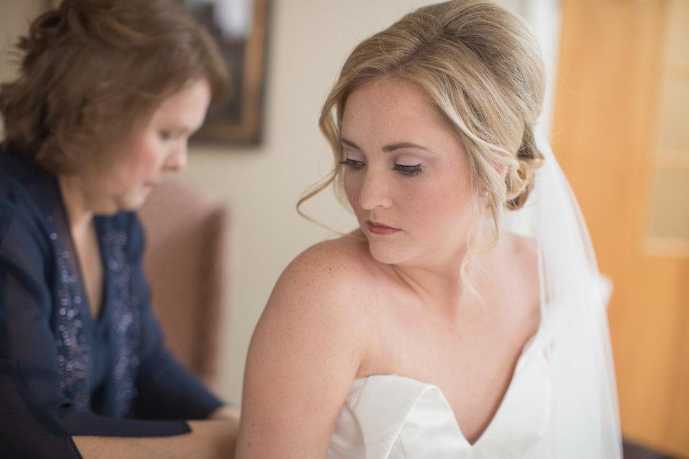 bride-photos-putting-on-dress