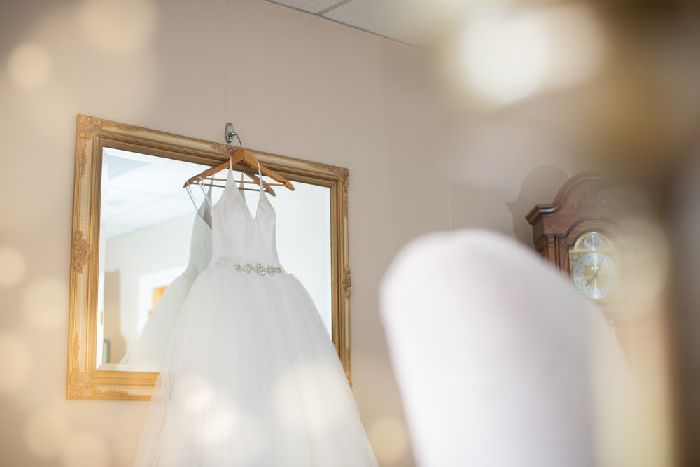 wedding-dress-hanging-before-wedding