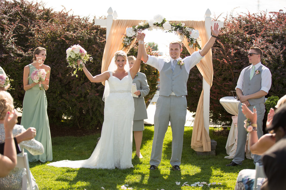 bride-and-groom-at-ceremony-celebrating-michigan-wedding-photographer