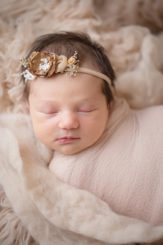 newborn close up of gorgeous headband at newborn studio session inside davison, michigan