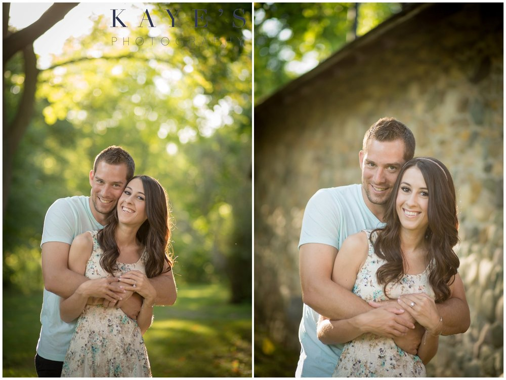 Cuddling during a couples photography session next to a barn