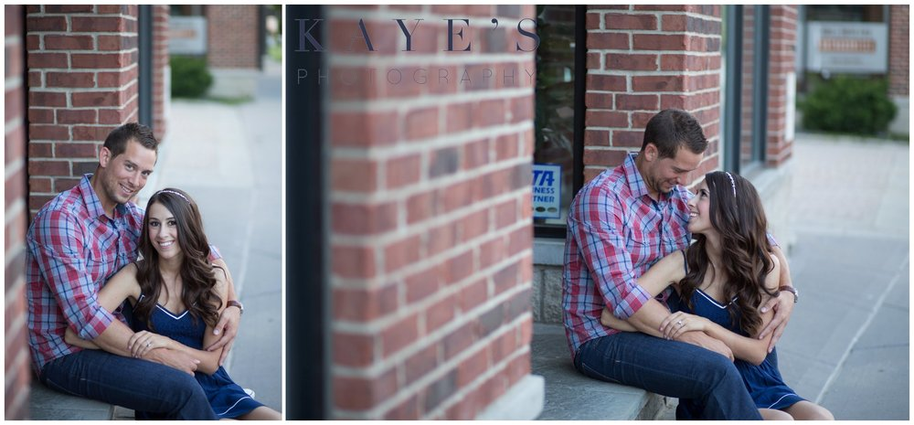 Couple cuddling on steps in the city during a professional photo shoot.