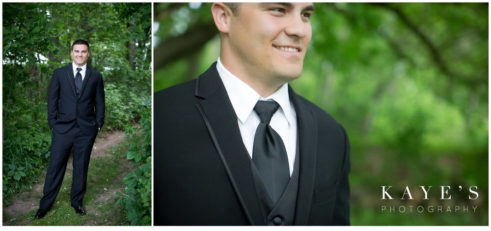 Black and white classic wedding with groom in black tuxedo in pontiac michigan