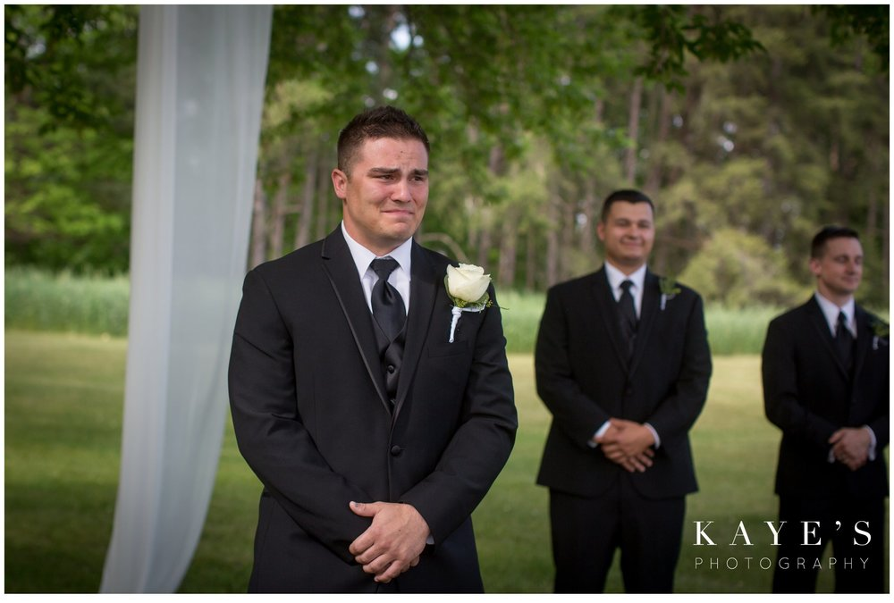 groom crying watching the bride come up the aisle in pontiac michigan wedding