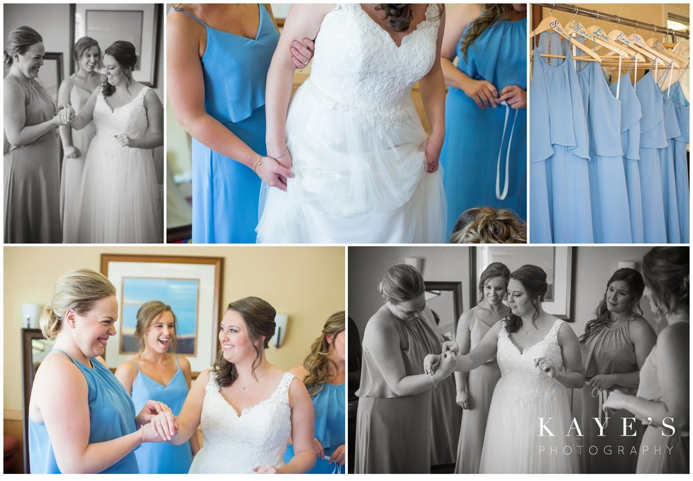 bride getting ready with bridemaids in light blue dressed