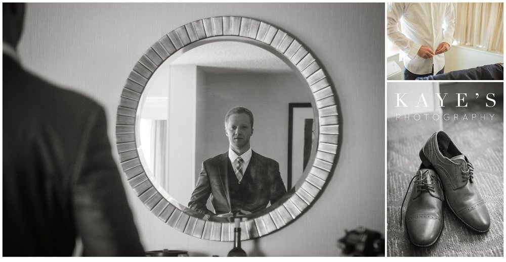 groom getting ready in room during plymouth michigan wedding