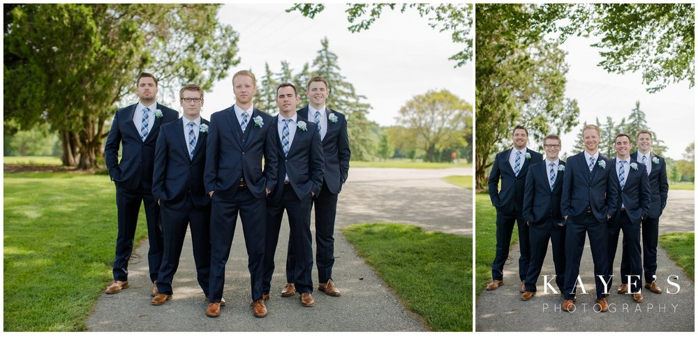 groomsmen portraits at golf course during wedding portraits