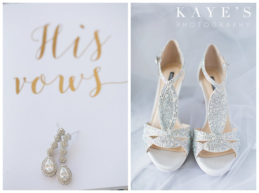Earrings on vow book and brides shoes in Flint Michigan during wedding