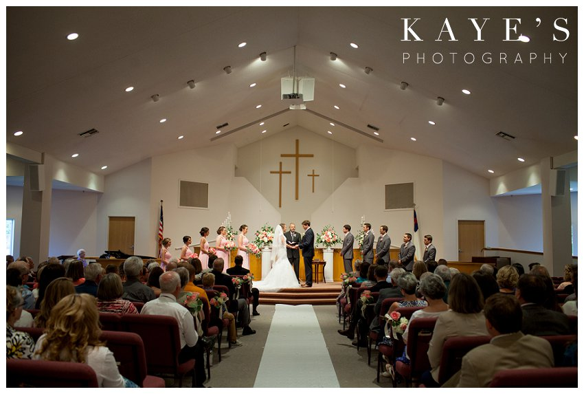 Bride and Groom at the altar during wedding ceremony in Flint Michigan