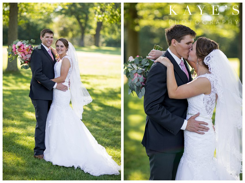 Bride and Groom kissing and posing in the grass in Flint Michigan at their wedding