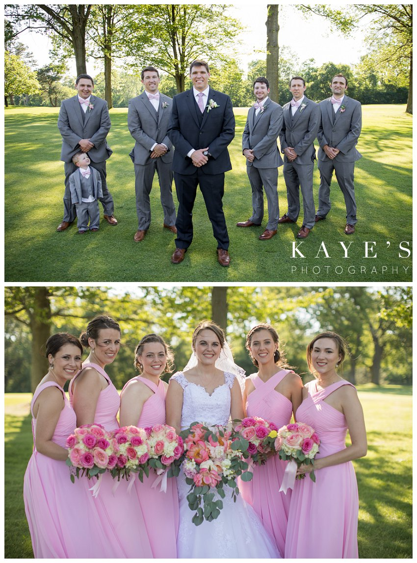 Bride and groom with the wedding party during photographs in Flint Michigan