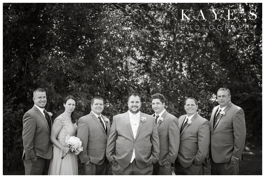groomsmen with groomwomen on wedding day at captains club in grand blanc michigan