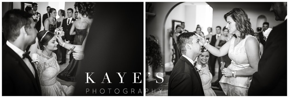 blessed by parents during a polish wedding by kayes photography