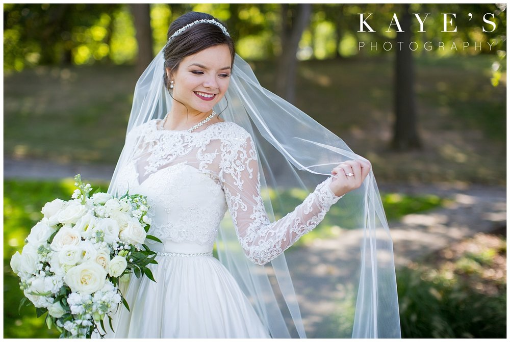 bride posing on wedding day at palazzo grand with kayes photography