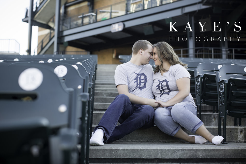 Engagement session in comerica park sitting in the chairs by kayes photography
