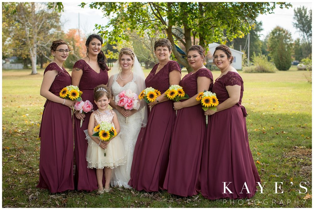 burgundy bridesmaid dresses paired with sunflowers in michigan wedding
