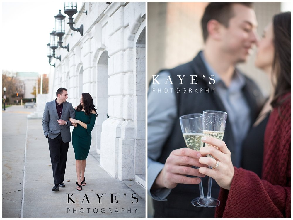 engagement portraits on a roof top celebrating with a glass of champagne in unique engagement session with kaye's photography