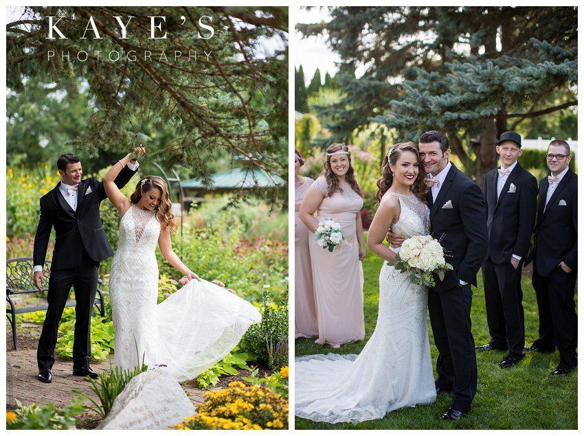 bride and groom with bridal party and twirling during wedding photos in Rochester Michigan