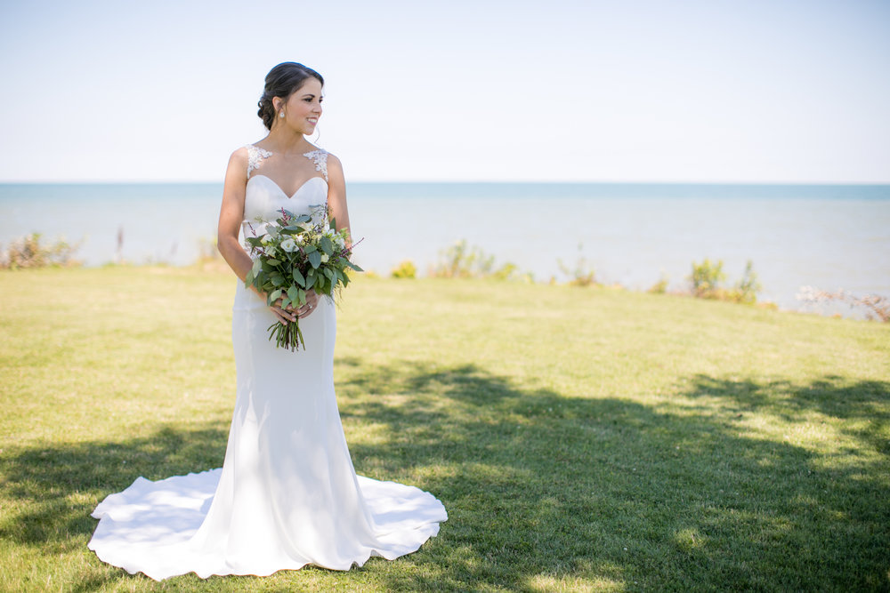 Bride posing for photo during wedding pictures with Detroit wedding photographer