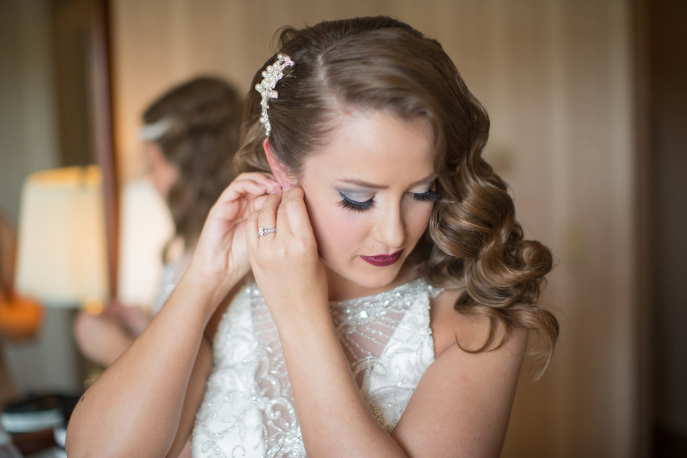 Bride getting ready to walk down the isle while Detroit photographer is taking wedding photos
