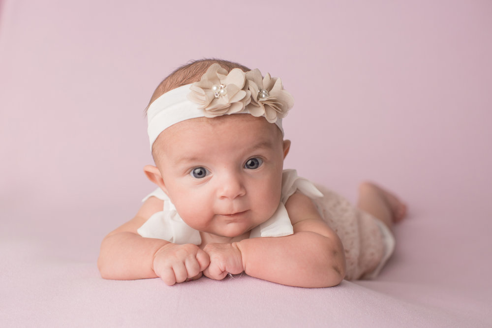 baby girl posing for professional pictures in Grand Blanc Michigan