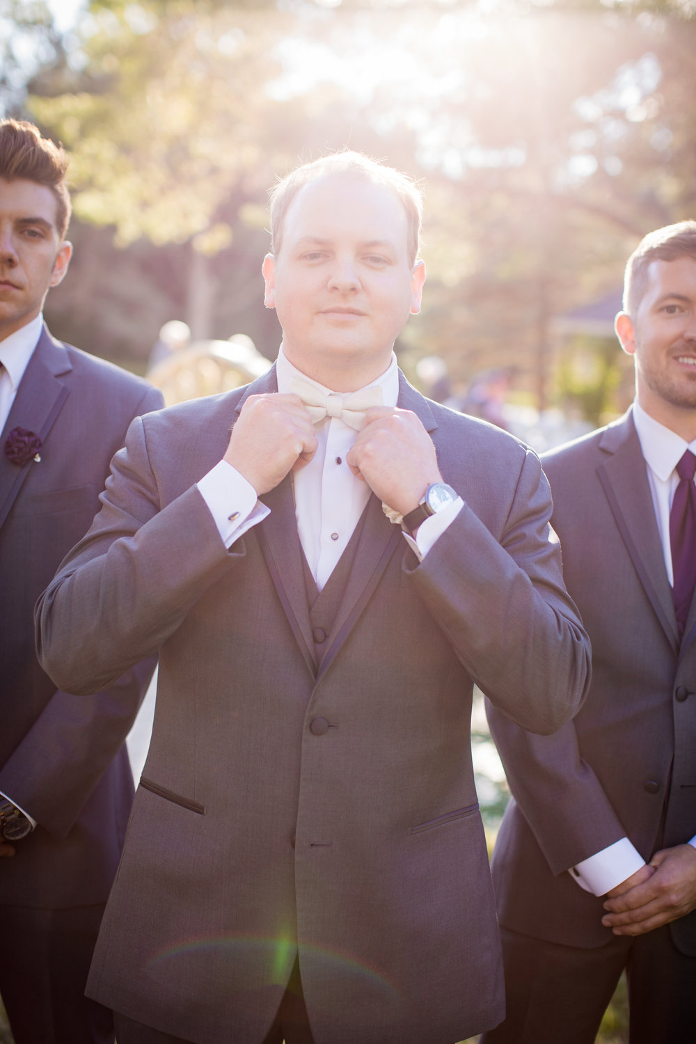 Groom posing for professional wedding photos