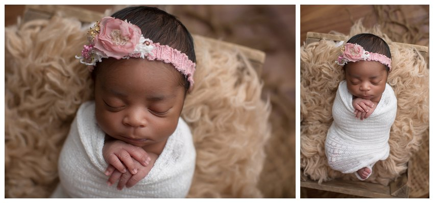 baby girl wrapped in blanket in basket posing for newborn baby photos