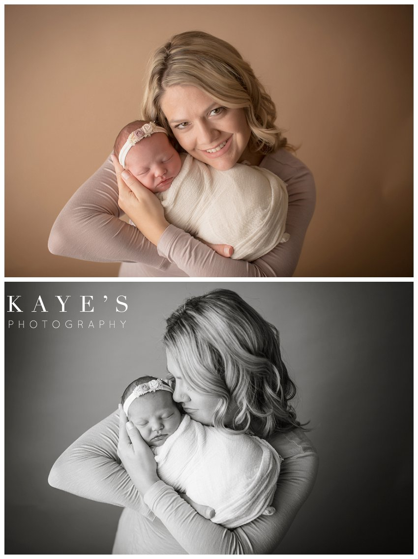 Newborn girl with mother during professional baby photo session