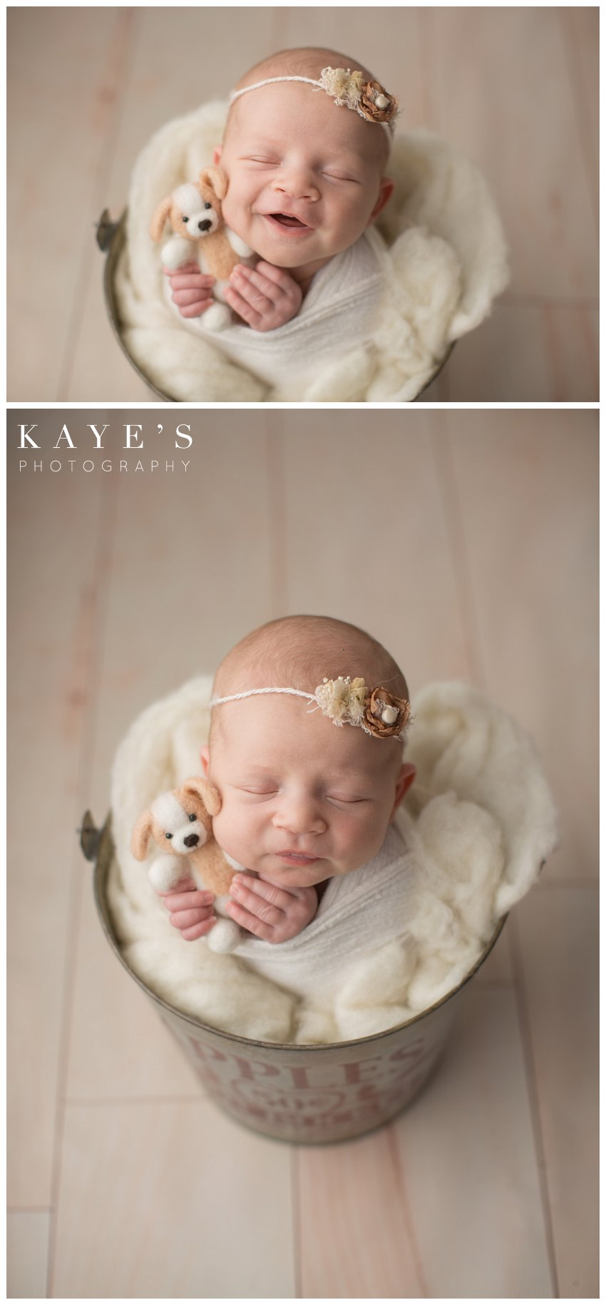 Newborn girl smiling with puppy during professional baby photos