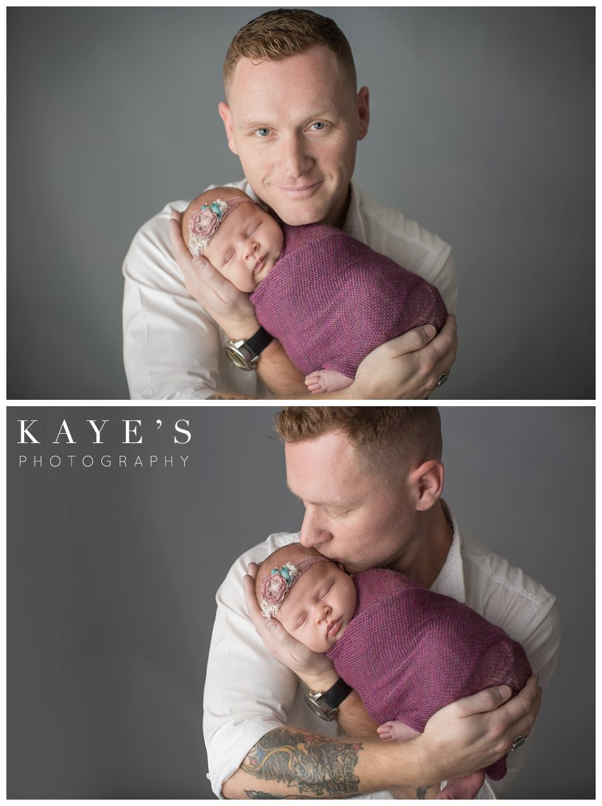 Newborn girl with daddy during professional baby photos