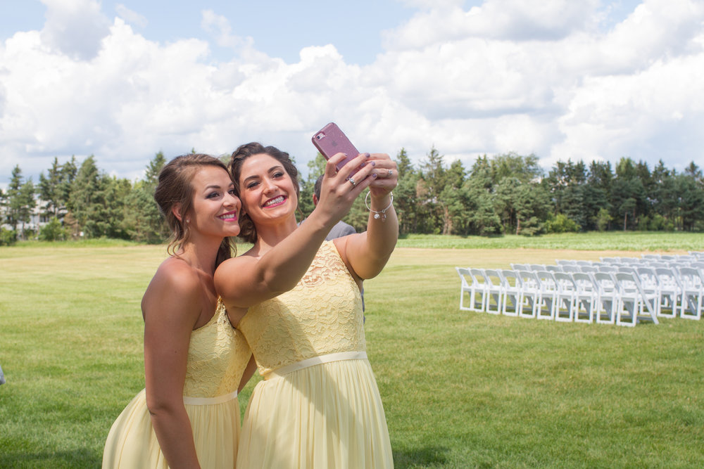 bridesmaids taking photos of themselves