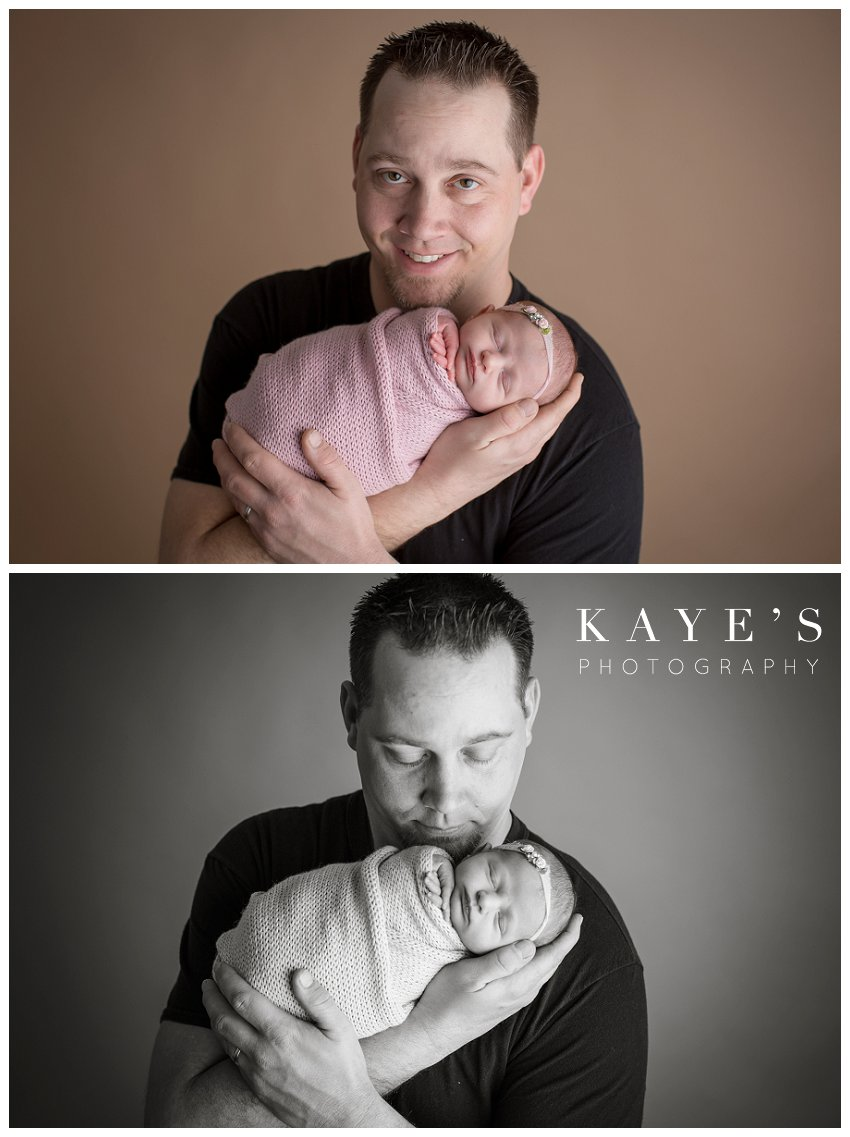 Baby girl with dad posing during newborn baby photos