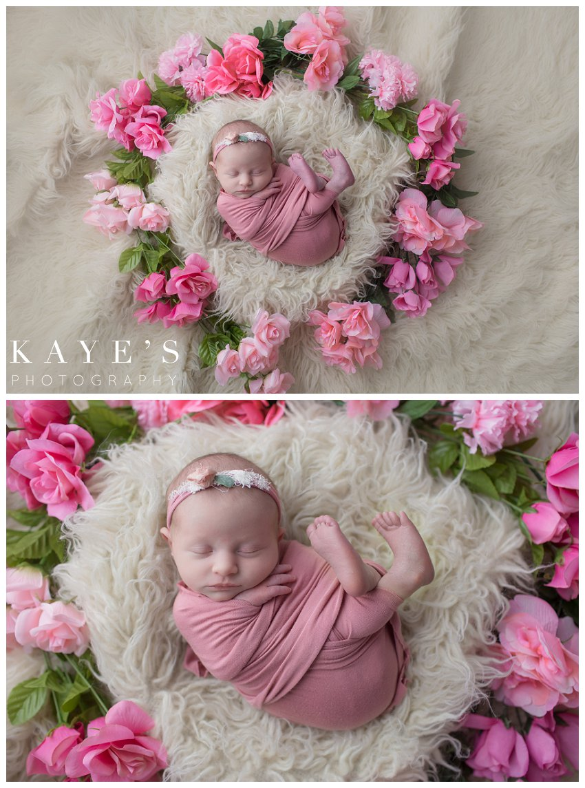 Baby girl surrounded by flowers during newborn pictures in grand blanc Michigan