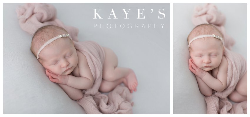 Baby girl in pink blanket posing for newborn baby photos in grand blanc Michigan