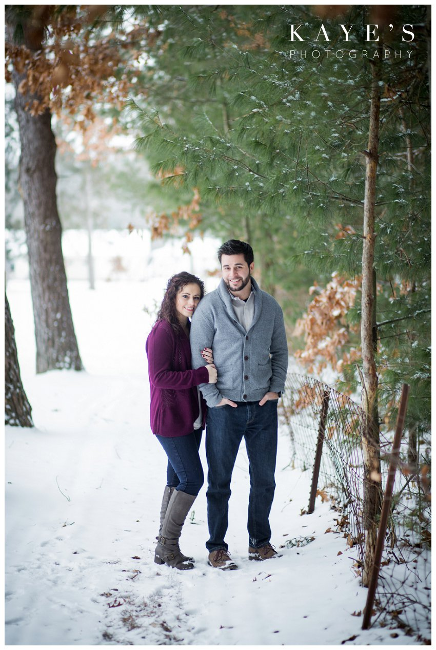 couple freezing in their winter engagement photos in grand blanc michigan