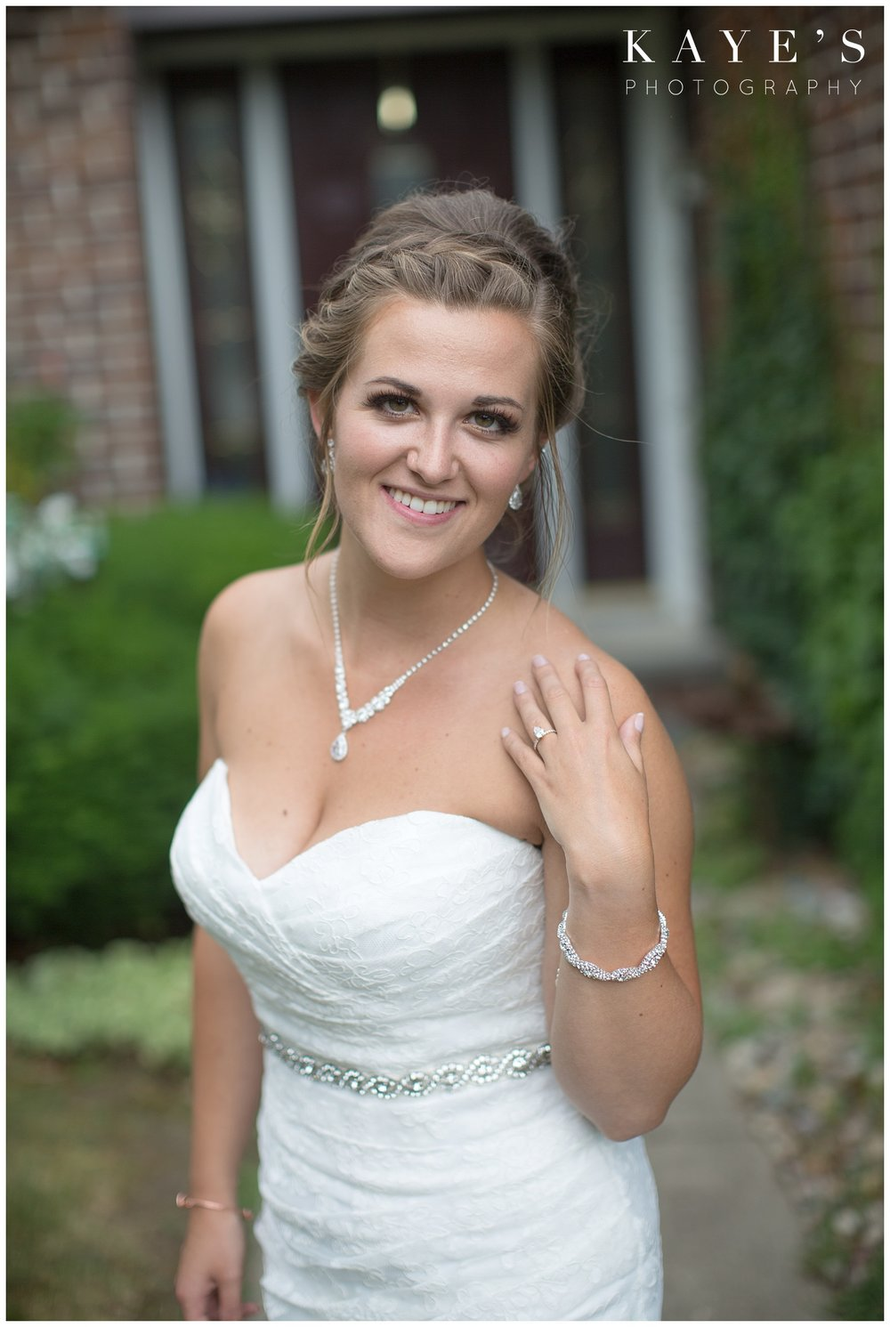 Gorgeous bride posing for professional wedding photographer in Flint Michigan!!