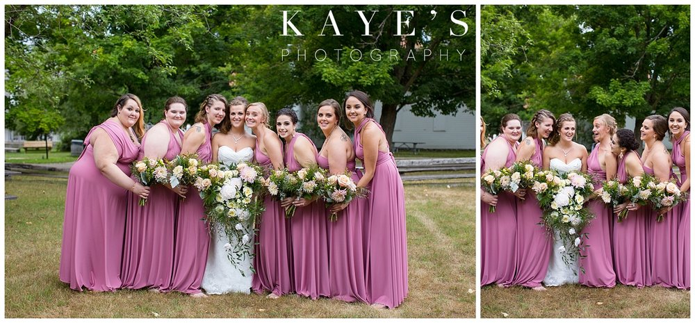 Bride with bridesmaids posing for professional photographer in flint michigan at crossroads village!!