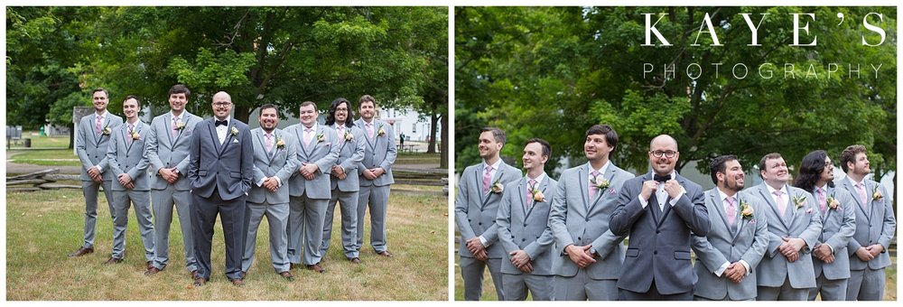 Groom with groomsmen posing for professional photographer in flint michigan at crossroads village!!