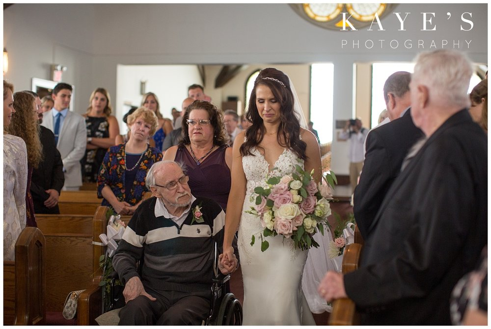 bride coming down the aisle with father in wheelchair in farmington michigan