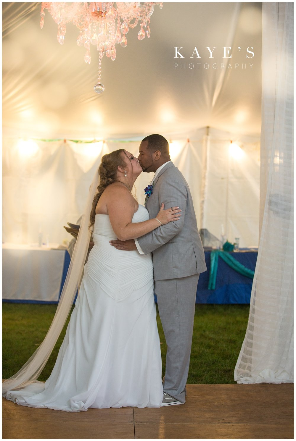Bride and groom first kiss during their beach wedding in tawas city Michigan