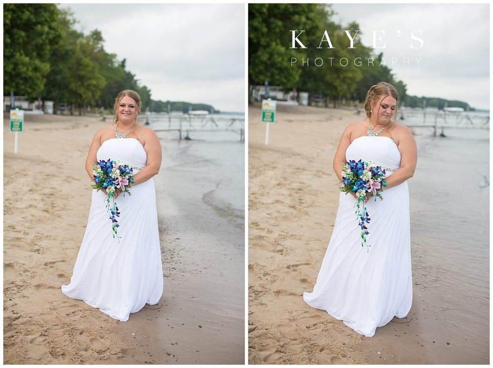 Bride posing for wedding photography in tawas city Michigan
