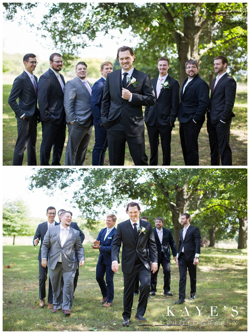 Groom posing with groomsmen during fall wedding in Flint Mi