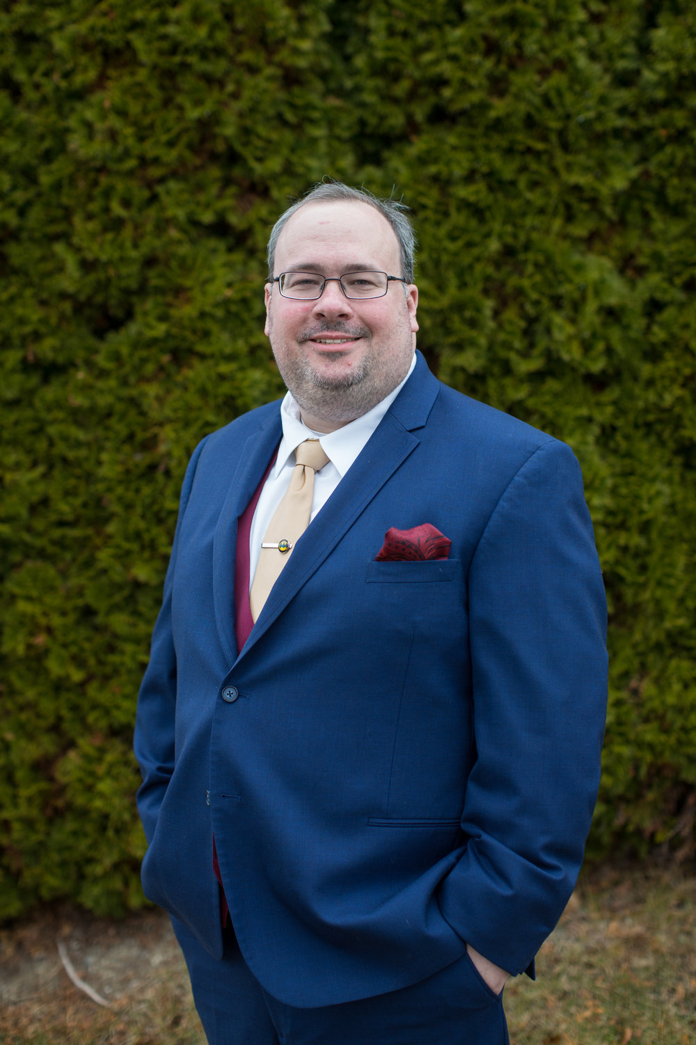 groom pictures during winter wedding in Sterling Heights, Michigan