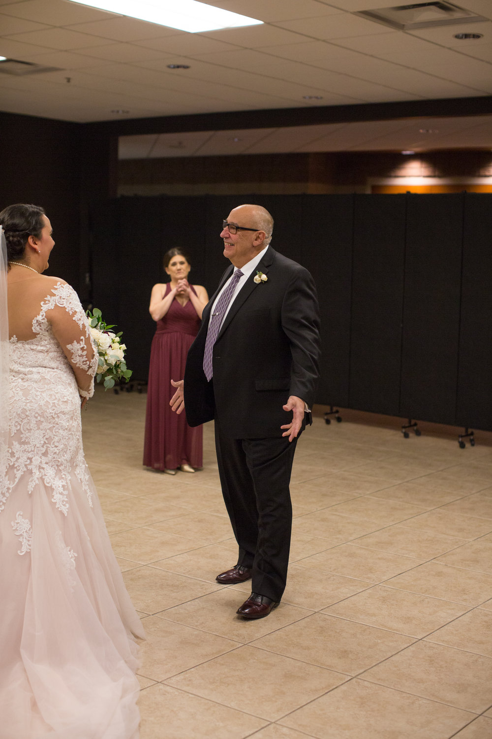 first look with father of the bride during a winter wedding in Sterling Heights