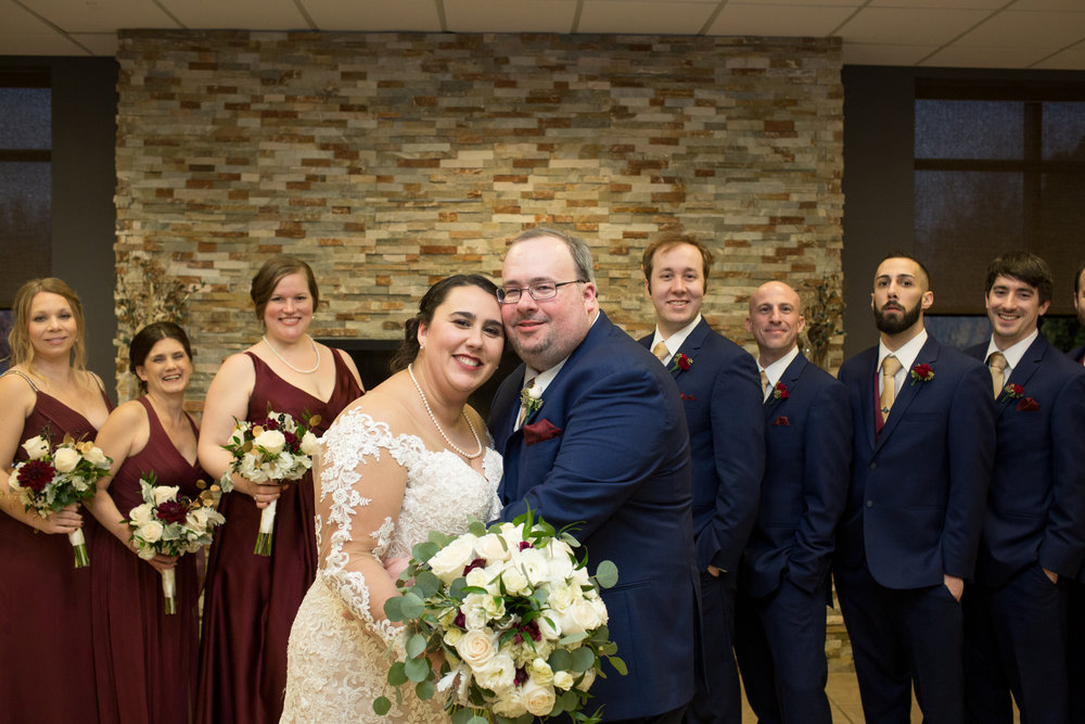 Bride and groom wedding pictures after ceremony at club venetian in sterling heights michigan