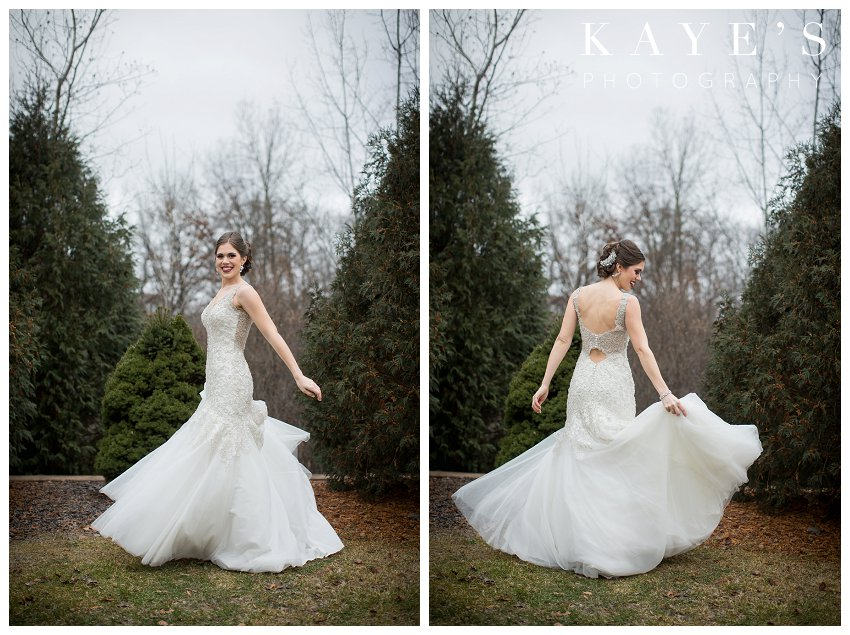 bride posing for winter wedding for crystal gardens in howell michigan
