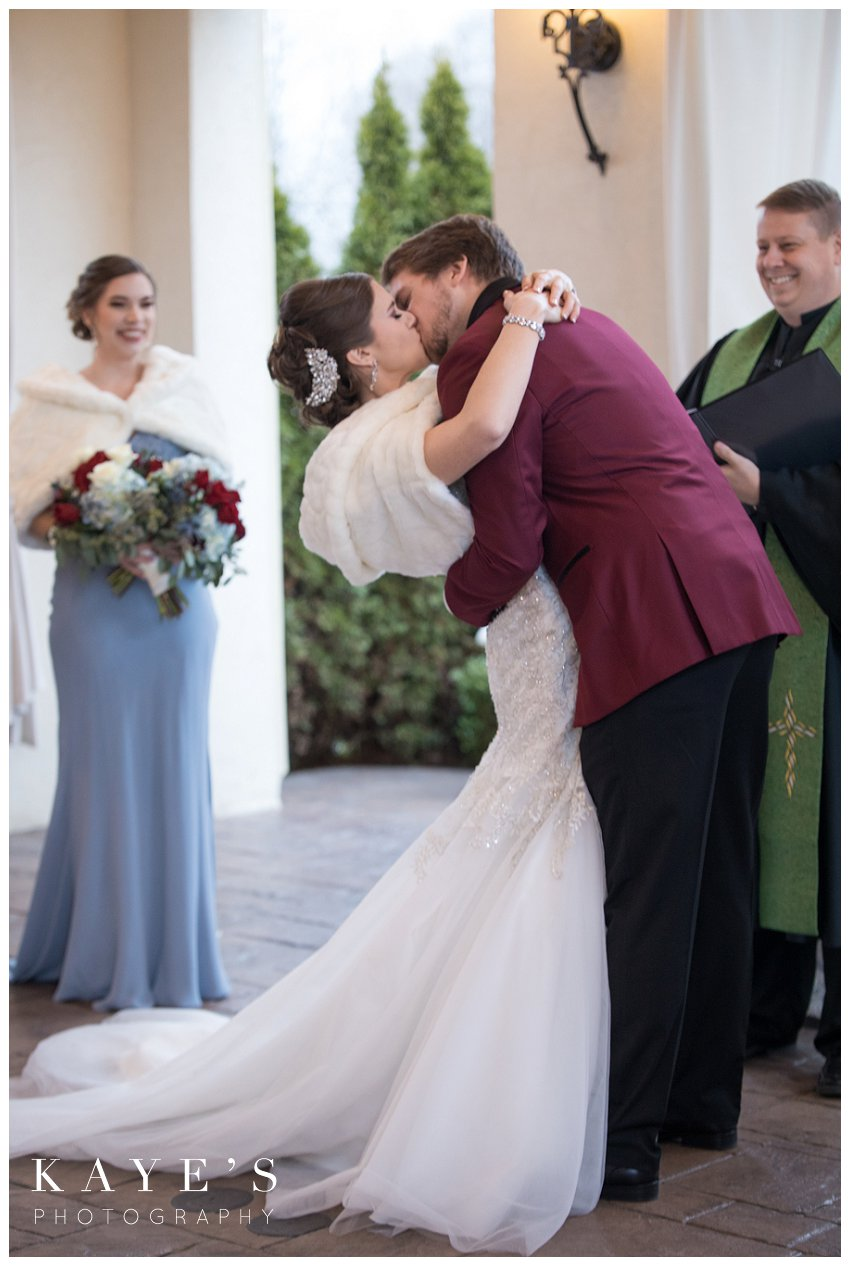 first kiss during ceremony of crystal gardens wedding