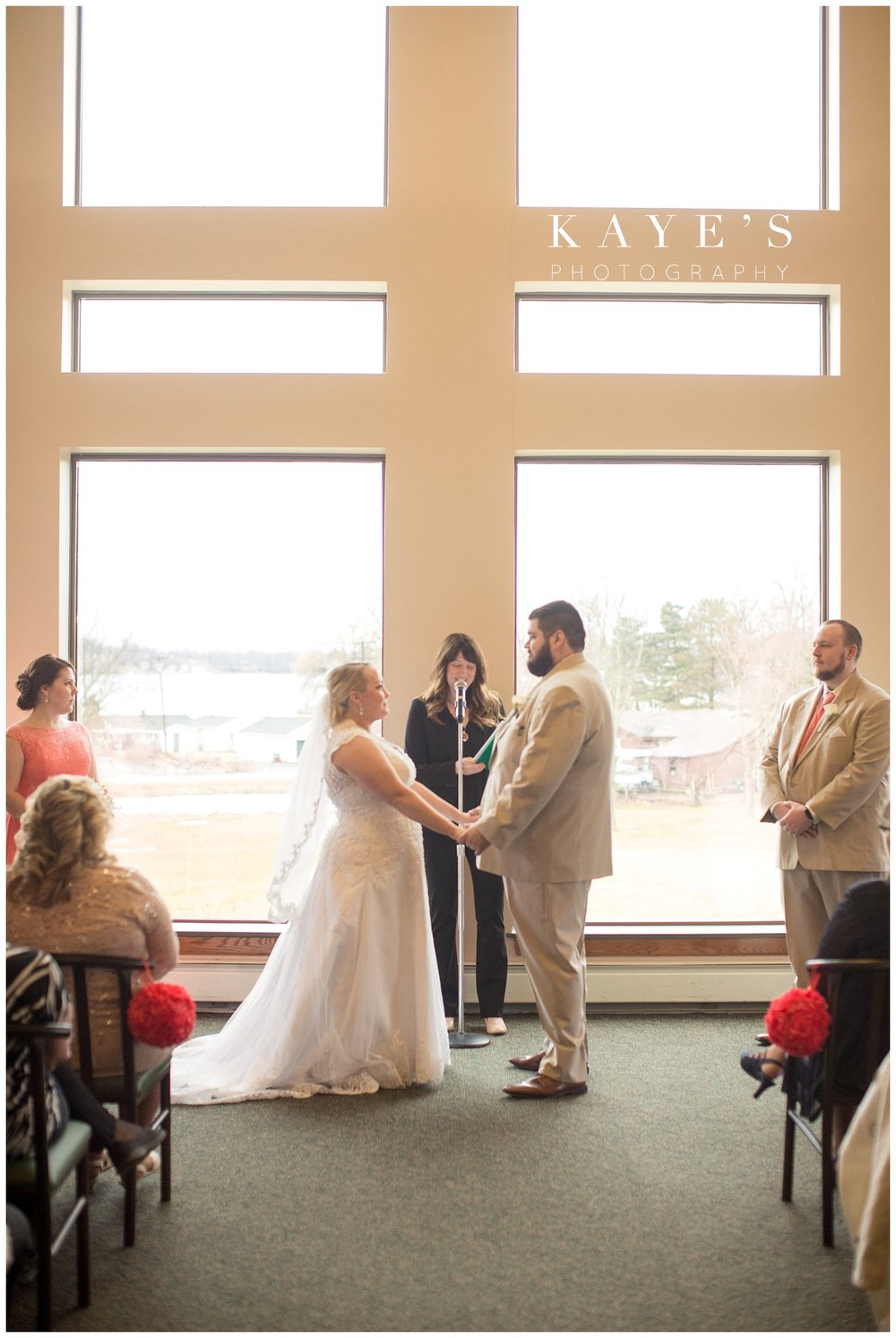 bride and groom at indoor ceremony location at lapeer country club
